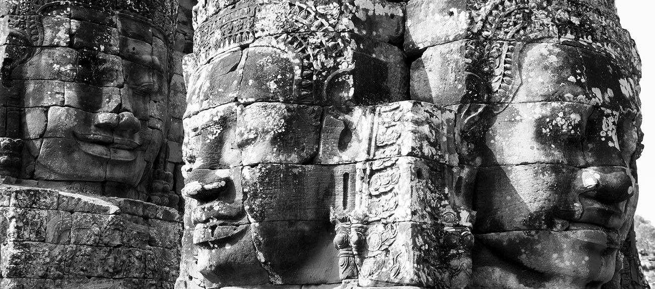 Three faces of carvings at Bayone Temple